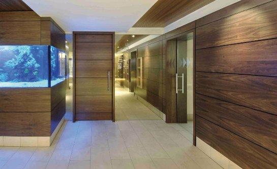Достоинства деревянных декоративных панелей